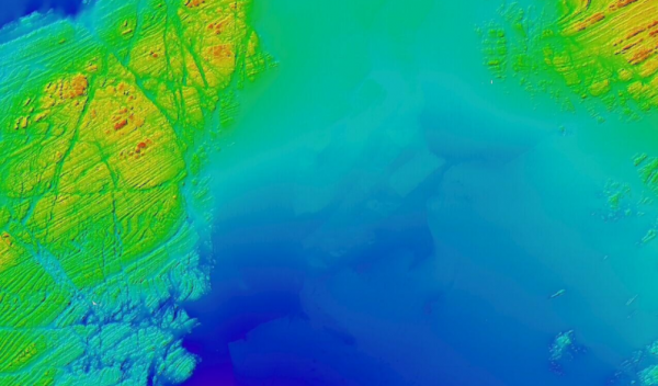 A bathymetric image of an area south of Plymouth Sound showing the combined multibeam echosounder datasets from three different survey vessels.