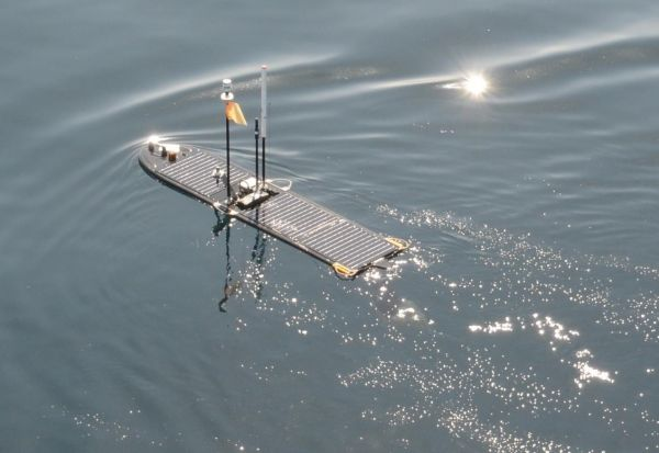 Cefas' Wave Glider Lyra sailing away on the start of the 41 day mission after being deployed from RV Cefas Endeavour.