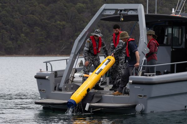 Australian Mine Warfare Team 16, MCDGRP and DSTG staff operating the Bluefin 9 autonomous underwater vehicle (AUV) from a Mine Countermeasure Support Boat (MCMSB) during a Project Sea 1778 equipment application course at Pittwater, New South Wales. (Image from Commonwealth of Australia, 2020)